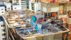 Timelapse View of Men Working on Construction Site - Zoom In Stock Footage