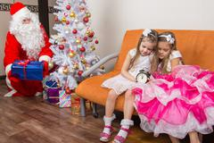 The sisters fell asleep while waiting for Santa Claus, who quietly put presen Stock Photos