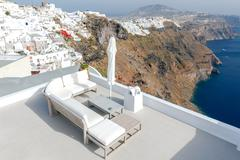 Fira. Aerial view of the city. Stock Photos
