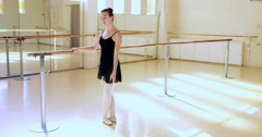 Side view of ballerina is doing exercises with a bar Stock Footage