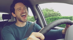 Happy handsome man with blue eyes driving car laughing 4K closeup retro style Stock Footage