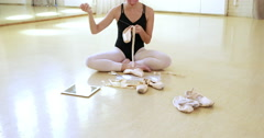 Ballerina is repairing her ballet shoes Stock Footage