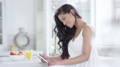 4K Portrait beautiful smiling woman relaxing at home with computer tablet Stock Footage