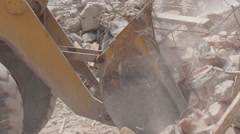 Huge pile of rubble, bulldozer charging shovel, smoke and dust close up. Stock Footage