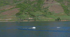 Recreation water sports jet skiis Deer Creek reservoir Utah mountains DCI 4K Stock Footage