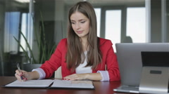 Business woman finishes work with documents in the office. Stock Footage