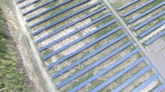 Aerial of Northern Ontario Canada Solar Farm - Panels in a Coniferous forest Stock Footage