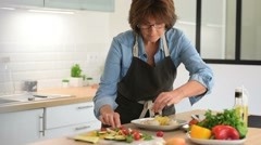 Senior woman taking pictures of dishes for blog - stock footage