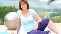 Senior woman doing relaxation exercises outside Stock Footage