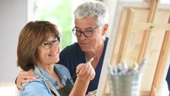 Senior woman painting on canvas - stock footage