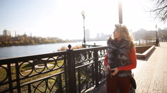 A girl with the dog walks along the promenade Stock Footage