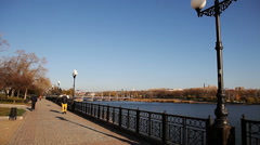 guy in the yellow pants and jacket walks along the promenade - stock footage