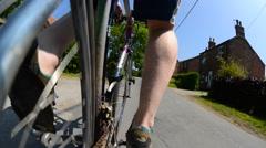 Man riding bike through countryside near york yorkshire uk Stock Footage