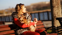 Attractive asian woman with dog in the park Stock Footage