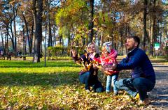 Carefree European Family Playing in Autumnal Park - stock photo