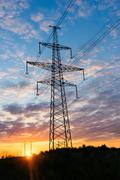Beautiful sunset view of high-voltage tower Stock Photos