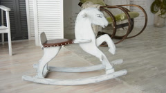 Old wooden rocking horse Stock Footage