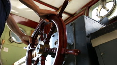 Ship's wheel under hand of a captain Stock Footage