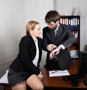 Sexual harassment. female boss sexually molested the male employee - stock photo