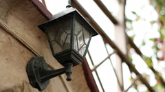 The exterior of a modern home. Street lamp hanging on the wall of a modern house Stock Footage