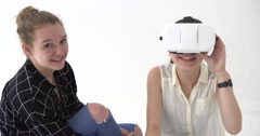 Teenagers playing with virtual reality headset - stock footage