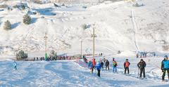"People in the queue for the lift in the ski park ""Gorki"" - stock photo"