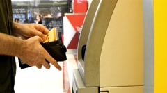 Man using credit card taking money ATM machine getting cash withdrawing savings Stock Footage