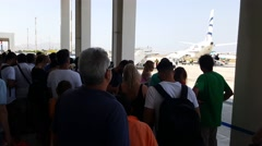 Mykonos Airport Greece – Summer. Passengers waiting embarkation before runway. Stock Footage