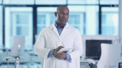 4K Medical scientist using computer tablet & interactive touch screen in lab Stock Footage