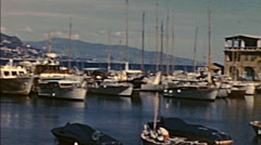 French Riviera 1960: boats docking at the port Stock Footage