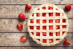 Raw strawberry pie preparation cake pastry food recipe Stock Photos