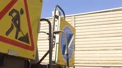 Traffic sign for road work on slowly moving truck. Street repair, highway Stock Footage