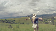 Female relaxing on the green meadow at sunny day in summertime. Slow motion Stock Footage