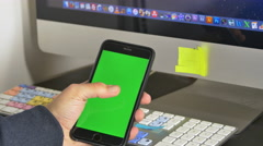 Man Hand Serching For An App In His Smartphone, Flipping Pages, Green Screen Stock Footage
