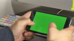 Young Man Playing A Video Game On His Smartsphone In Landscape Mode Stock Footage
