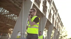 Road workers with Traffic rod isolated and walkie talkie work at checkpoint toll Stock Footage