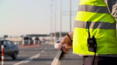 Traffic police with Traffic rod isolated and walkie talkie work at highway - stock footage