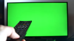 Hand With Remote Control Changing Tv Chanels, Green Screen Tv Stock Footage