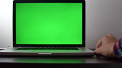 Young Man Working At His Laptop, His Hand On His Mouse, Green Screen - stock footage