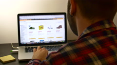 Young Man Internet Shopping, Searching The Page Of An Online Store Arkistovideo