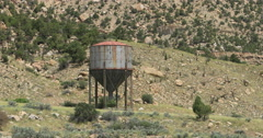 Antique old steam engine water tower Utah desert mountains DCI 4K Stock Footage