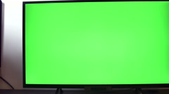 Pan Over A TV Set With Green Screen - stock footage