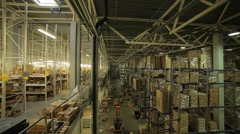 Huge warehouse and forklifts, racks with goods Stock Footage
