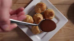 Chocolate sauce over choux pastry Stock Footage