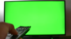 Left Handed Man Changing Channels Of His TV Set, Green Screen - stock footage