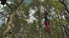 Girl moves on a Tightrope In Rope Park. Long shot - stock footage