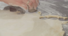Tracking shot of cookie cutter cutting cookies Stock Footage