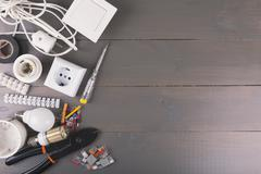 electrical tools and equipment on wooden table with copy space - stock photo
