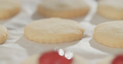Macro shot of jam on butter cookies Stock Footage