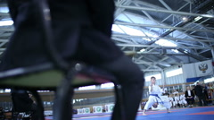 Referee oversees the performance karate fighter - stock footage
